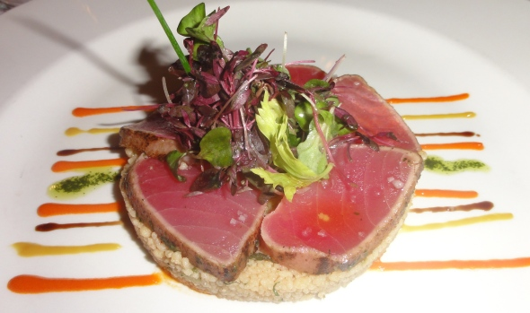 Marinated tuna with limes and herbs, Mediterranean salad, peppers coulis at Bistro de Paris